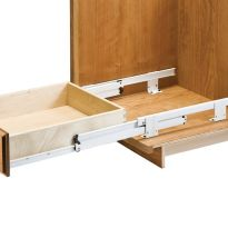 Simple solution for a floor-mounted rollout shelf or drawer.