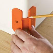 Hold trim gauge up to rounded corner and mark for perfect fitting trim.