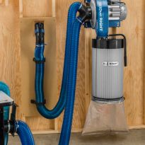 A Canister Filter for the Rockler 1250 Wall-Mount Dust Collector on the wall in a shop.