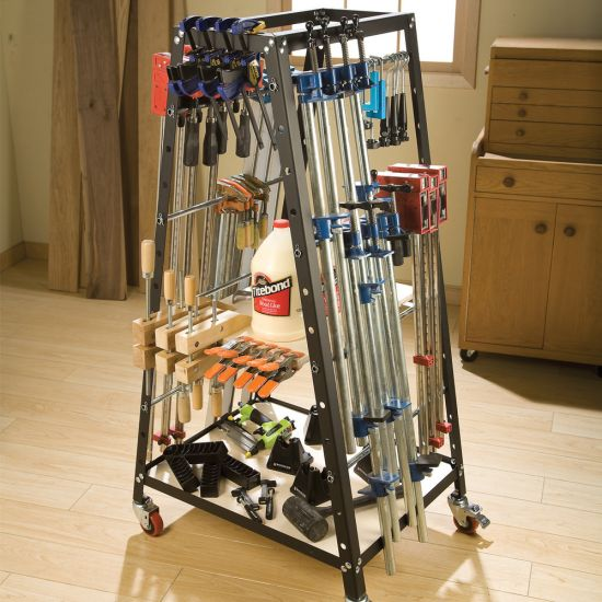 The Rockler Pack Rack® Clamp & Tool Storage System holding clamps and other various tools and supplies