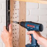 Man using the JIG IT® Shelving Jig w/Self-Centering Bit