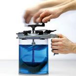 The Rockler Mixing Mate® Paint Lid, Gallon Size mixing blue paint