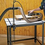 The Cord and Hose Holder holding the tubing and cord for a sander from behind