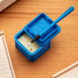Rockler Silicone Glue Keeper with glue brush resting in lid and glue dripping into it.