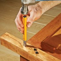 Simply tap the recess out using a steel hammer and the chisel
