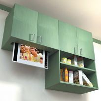 Keep a TV or monitor cleverly concealed with a matching cabinet