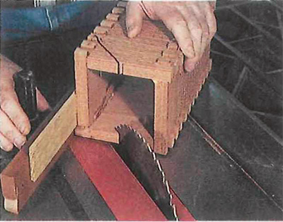 Cutting birdhouse body at a 45 degree angle at table saw