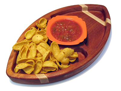 football-shaped snack tray with chips and salsa