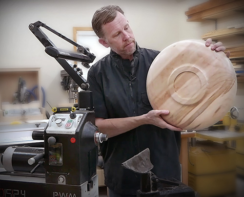 woodworking showing the bottom of a wood turned platter