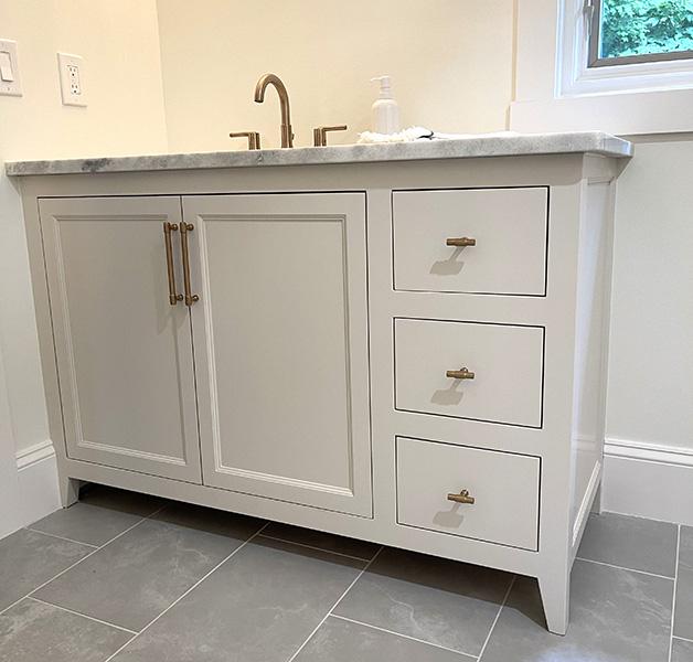 painted white bathroom vanity with three drawers