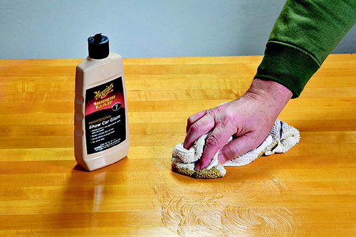 Wiping down tabletop finish with automotive polish