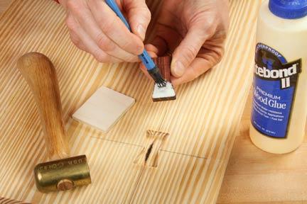 Applying glue to inlay insert with glue brush