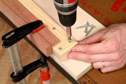 Attaching a stop block to tapering jig