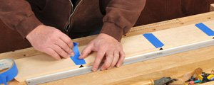 Holding together parts of a miter jointed frame with tape