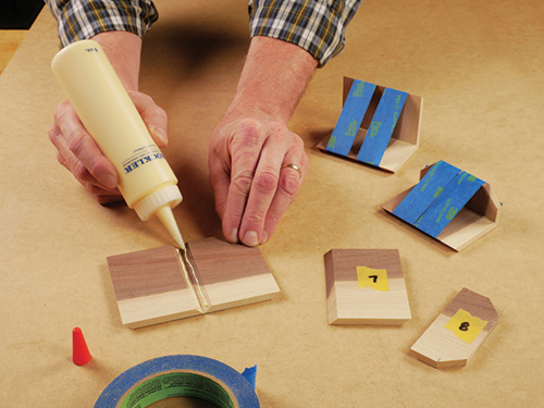adding wood glue to mitered edges