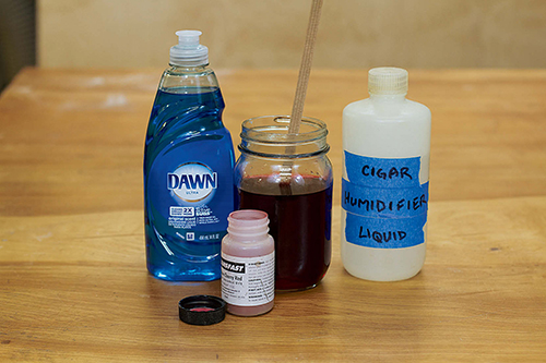 Mixing dye with dish soap to create a smoother flow
