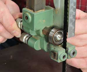 Making adjustments to the thrust bearings on a band saw