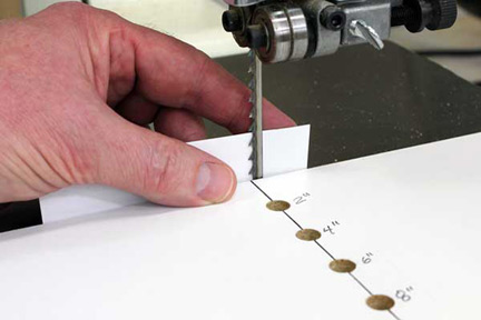 Checking blade teeth positioning against circle cutting jig