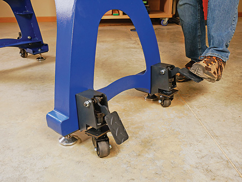 Adjusting foot activated pedal casters on lathe base