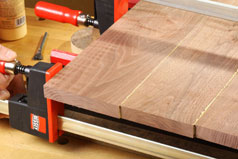 Adjust pressure on bar claps to ensure a tight fit during panel glue-up