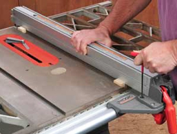 Making adjustments to table saw rip fence parallel to the blade