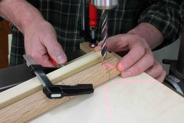 Aligning drilling jig using laser cross on drill press