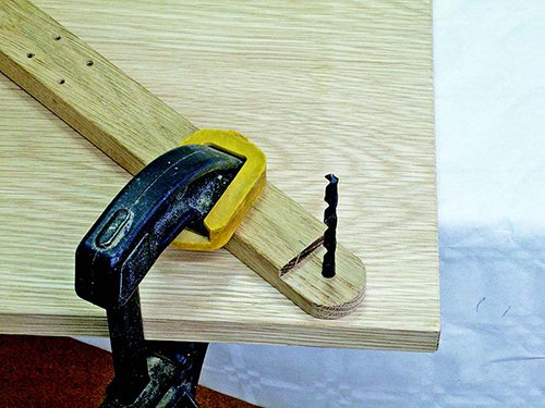 Using drill bit to align miter cutting arm for clamping