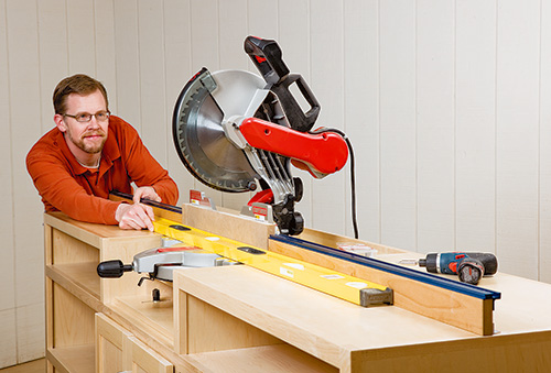 Checking straightness of miter saw and fence ontop of cabinet