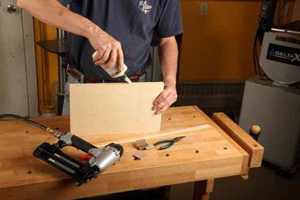 Spreading glue on plywood edge