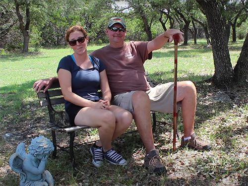 April Wilkerson and her father show off her walking cane project