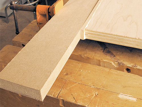 Attaching cherry edging to plywood cabinet fronts