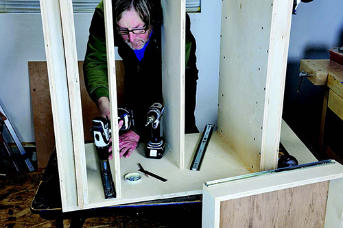 Adding drawer slides to lower carcass of tool cabinet casework