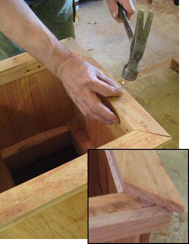 Nailing planter trim onto the cedar base