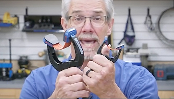 man holding a pair of bandy clamps