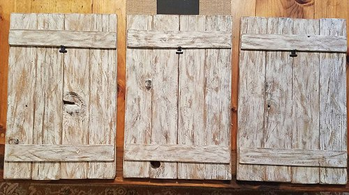 three unfinished panels of old barnwood
