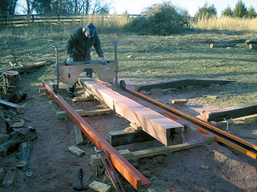 Freshly cut wood beam on saw mill outfeed