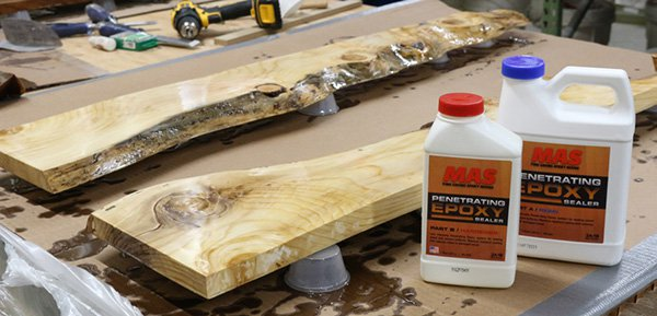Two live-edge boards pre-treated with epoxy