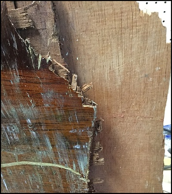 Close-up of splintered plywood sailboat centerboard