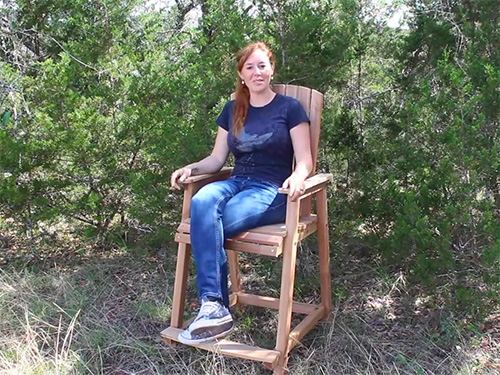 April Wilkerson demonstrating her bar height adirondack chair