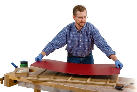Attaching laminate top to table saw to outfeed table