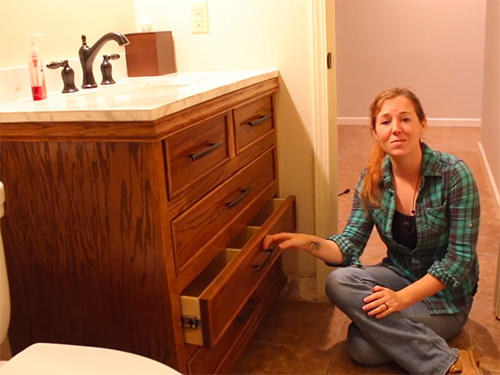 April Wilkerson demonstrating her finished bathroom vanity project