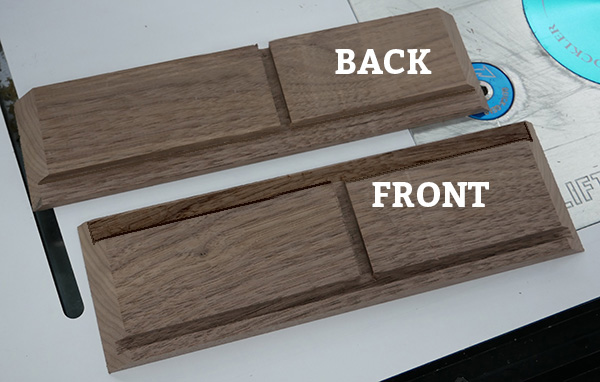 showing from and back wood pieces after being routers