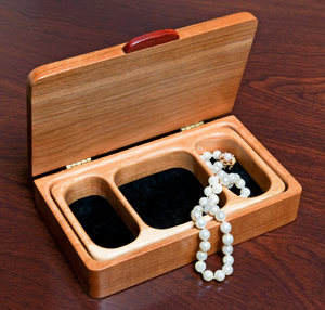 A small jewelry box made from cherry wood