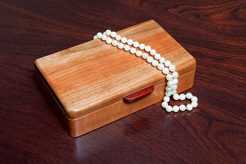 Small jewelry box made with cherry wood