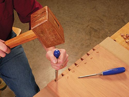 Cutting waste around dovetail sockets with a chisel