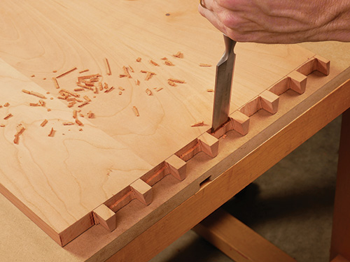 Cutting away waste from the bottom of dovetail sockets with a chisel