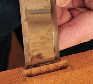 Cleaning a mortise cut with a chisel