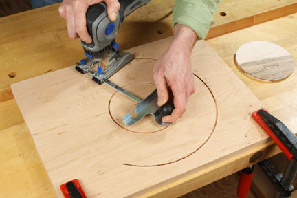 Using circle cutter to separate center inlaid portion from lazy susan tray