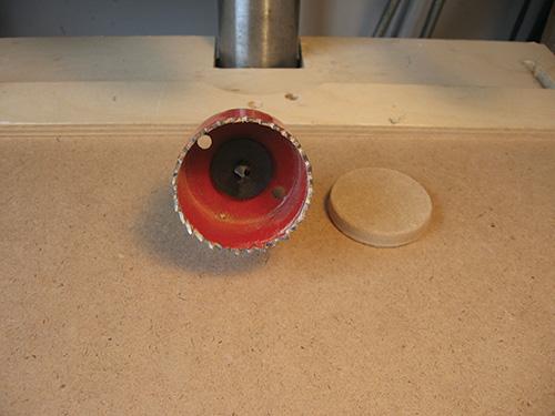 Small circular piece cut using a hole saw
