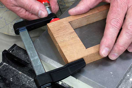 Gluing and clamping two halves of drawer box front frame